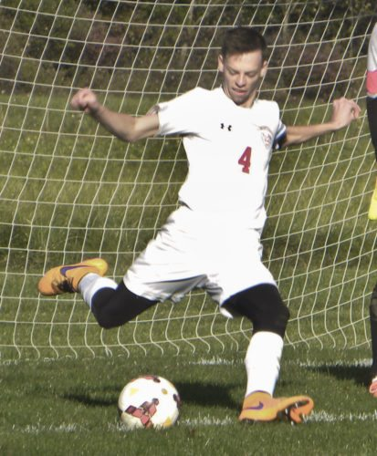 Tribune Chronicle / Eric Murray Lordstown's Garrett Behner is making a goal kick Tuesday against Garfield.