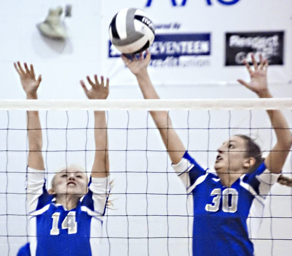 Tribune Chronicle / Bob Ettinger Leah Carlson (left) and Jensen Silbaugh of Lakeview attempt to make the block in Division II district semifinal action Tuesday at Jefferson's Falcon Gymnasium.