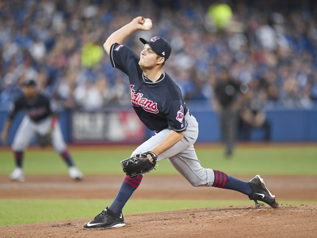 Cleveland Indians starting pitcher Trevor Bauer delivers to the Toronto Blue Jays during first inning of game three American League Championship Series baseball action in Toronto on Monday, Oct. 17, 2016. (Frank Gunn/The Canadian Press via AP)