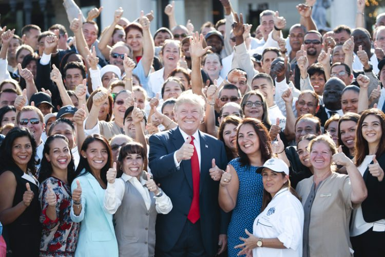Republican presidential candidate Donald Trump poses for photographs during an campaign event with employees at Trump National Doral, Tuesday, Oct. 25, 2016, in Miami. (AP Photo/ Evan Vucci)