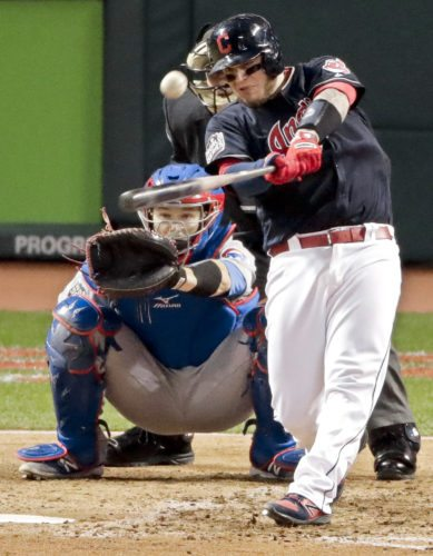 Cleveland Indians' Roberto Perez hits a home run against the Chicago Cubs during the fourth inning of Game 1 of the Major League Baseball World Series Tuesday, Oct. 25, 2016, in Cleveland. (AP Photo/Charlie Riedel)