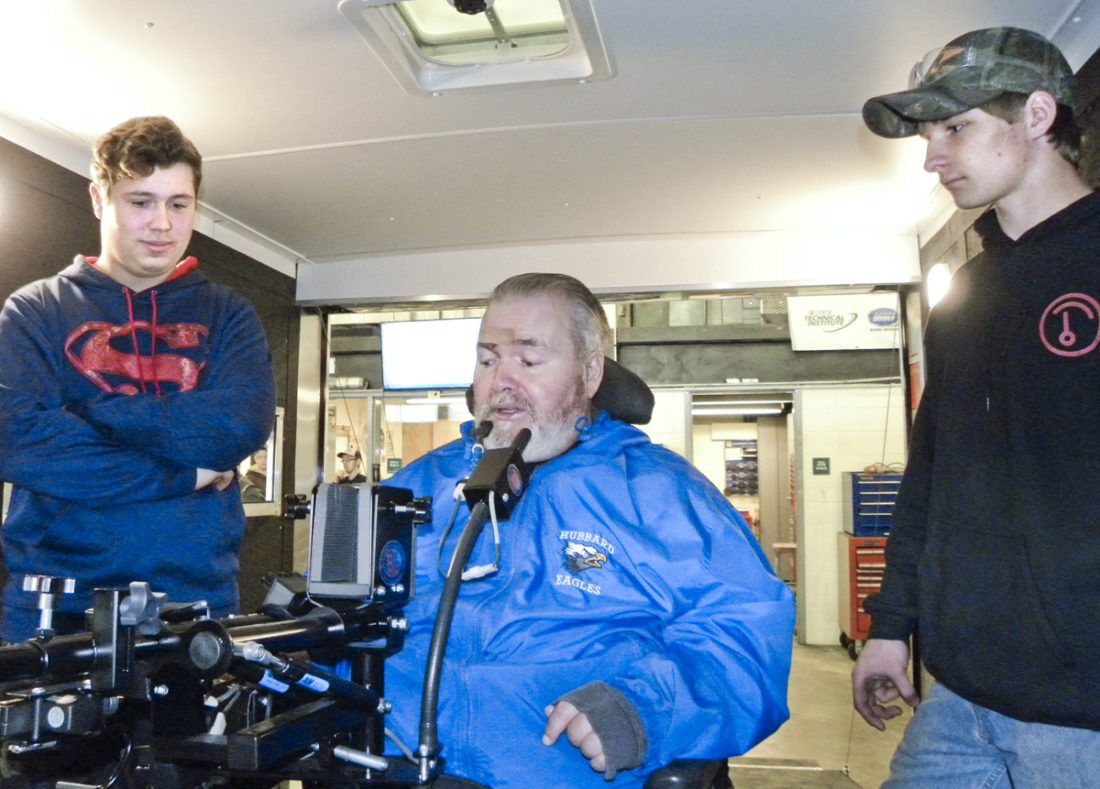 Tribune Chronicle / Virginia Shank  John Karlovic of Hubbard, center, a quadriplegic, examines the adaptive technologies inside his new hunting trailer built by students at the Mahoning County Career and Technical Center, including Nathan Gasser, 18, a senior from Austintown, left, and Nick Clark, 17, a junior from Letonia.