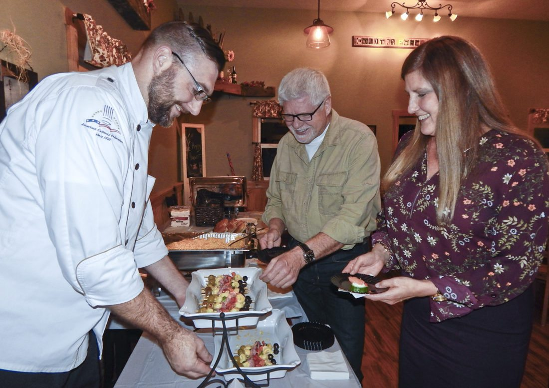 Tribune Chronicle / Bob Coupland Scott Danchise, executive chef at Lake Vista of Cortland, serves Mayor Jim Woofter and Leni Magdych, both of Cortland, at the recent Taste of Cortland.