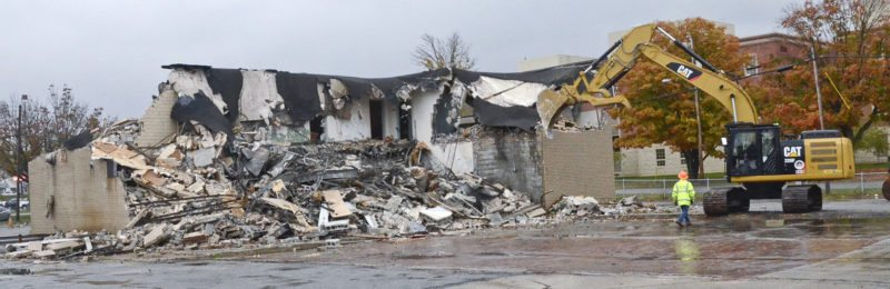 102716...R TC DEMO 3...Warren...10-27-16... An old Trumbull County building located on Panther Drive NE in Warren is demolished Thursday morning by the Trumbull County Engineers Dept...by R. Michael Semple