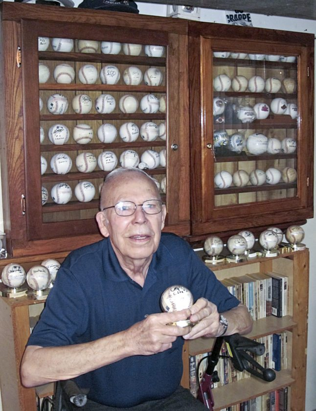 Bernie Zickefoose, 84, of Southington, holds a baseball autographed by former Indians pitcher and 2008 American League Cy Young Award winner Cliff Lee. Zickefoose has collected about 150 autographed baseballs, most during spring training in Florida.