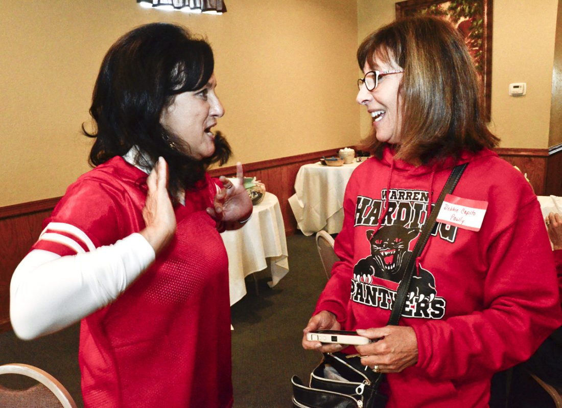1028166...R WGH CLASS 1...Warren...10-28-16... Former WGH Panther cheerleader Sandy Cristo of Houston, TX, left, and good friend and former Panther majorette Debbie Capito Paully share memories together at a gathering of the WGH Class of 1972 at the Sunrise restaurant Friday before the Howland vs. WGH Football game at Mollenkopf stadium...by R. Michael Semple