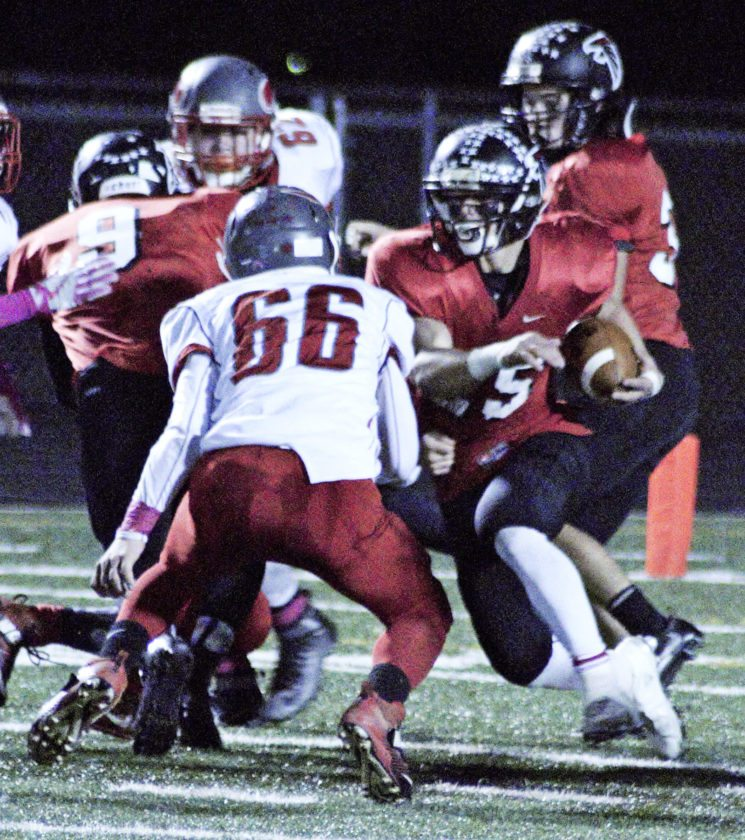 Tribune Chronicle / Bob Ettinger Jeremiah Knight of Jefferson attempts to elude tacklers as Riley McCleary of LaBrae prepares to make the hit Friday night at Falcon Pride Stadium.