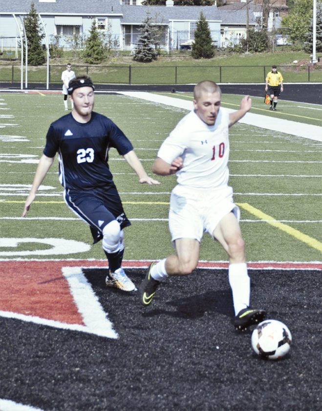 Dominic D'Amico of Lordstown outruns Nathan Murdock of Rootstown to the ball in Division III district tournament action on Saturday afternoon.
