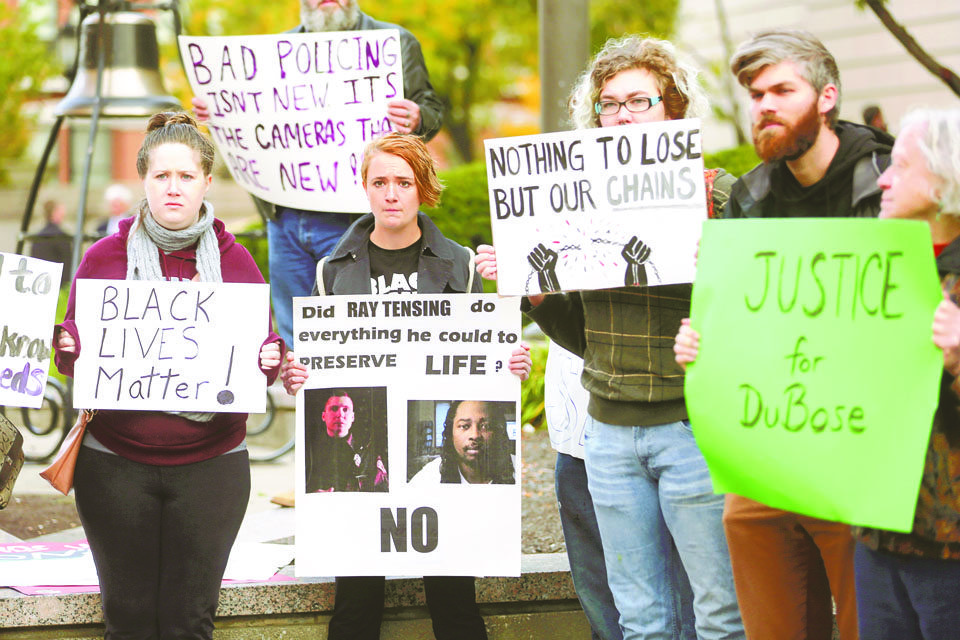 Protesters demonstrate at the Hamilton County Courthouse for the start of the Ray Tensing trial, Monday, Oct. 31, 2016, in Cincinnati. The former University of Cincinnati police officer is charged with murder in the shooting death of Sam DuBose. (Liz Dufour/The Cincinnati Enquirer via AP)