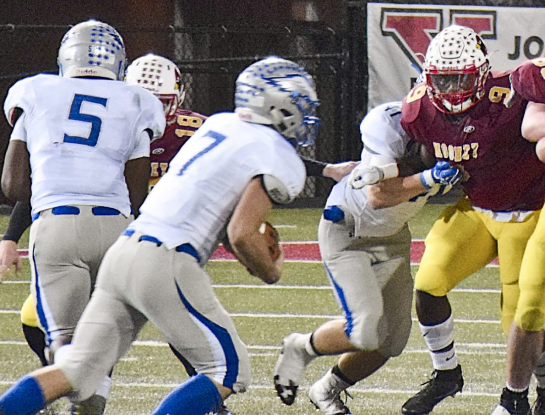 Tribune Chronicle / Eric Murray Hubbard's Dillon O'Hara (7) prepares to cut through a hole opened by his blockers in the Cardinal Mooney defense.
