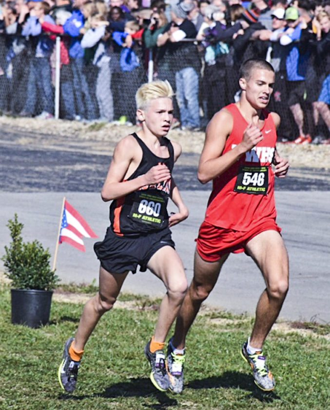 Tribune Chronicle / John Vargo  Howland's Vinny Mauri, left, heads for the finish line Saturday in the Division I cross country state meet.