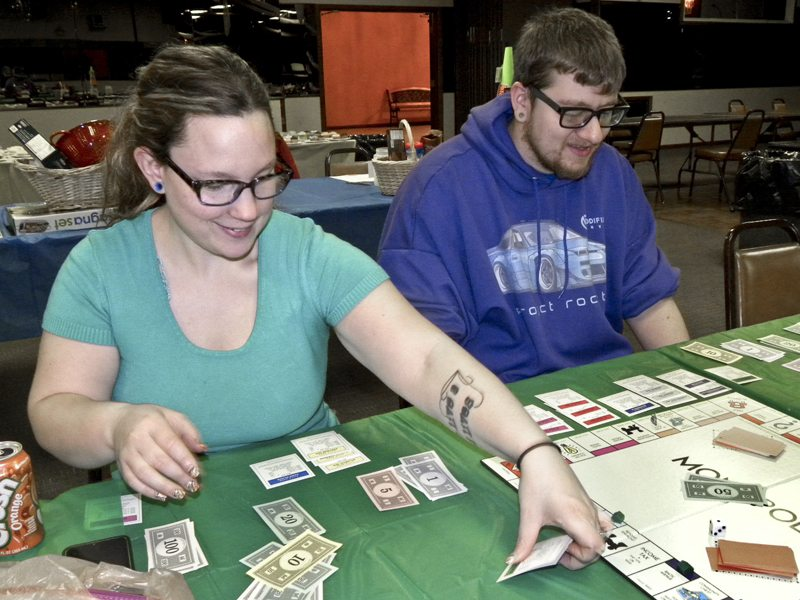 Tribune Chronicle/Andy Gray Jade, left, and Kyle Pascarella of Girard were bankrupt by David Rogers of Niles in an early round of a Monopoly tournament Saturday at McMenamy's Banquet Center. The tournament was held to raise money for field trips for Niles City Schools' preschool program.