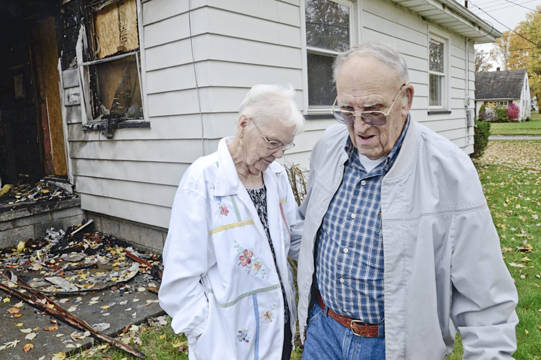 Tribune Chronicle photos / R. Michael Semple  Retired steelworker Eldred Davis and his wife, Ruth, both 81, said they are saddened by the vandalism that occurred at their Southern Boulevard NW home after it was damaged by a fire.