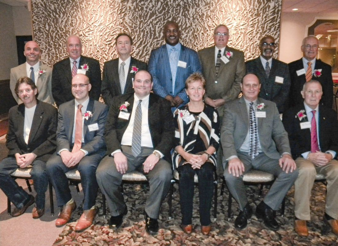 "The Trumbull County Sports Hall of Fame held its 14th induction ceremony last week with Youngstown State president Jim Tressel praising the 13 new inductees who include (front, from left) Christopher Sanders, accepting on behalf of his uncle James ""Jimmy"" Sanders, George Fetchko III, Matt Emch, Jan Burns, Gerald Lenarcic, Pat Merrick, (rear, from left) Carl Capellas, Jeffrey Rogner, accepting on behalf of his father, Col. Harris E. Rogner, Ray Muche, Vince Peterson, Frank Supancic, Tim Davis and Bill Miller."