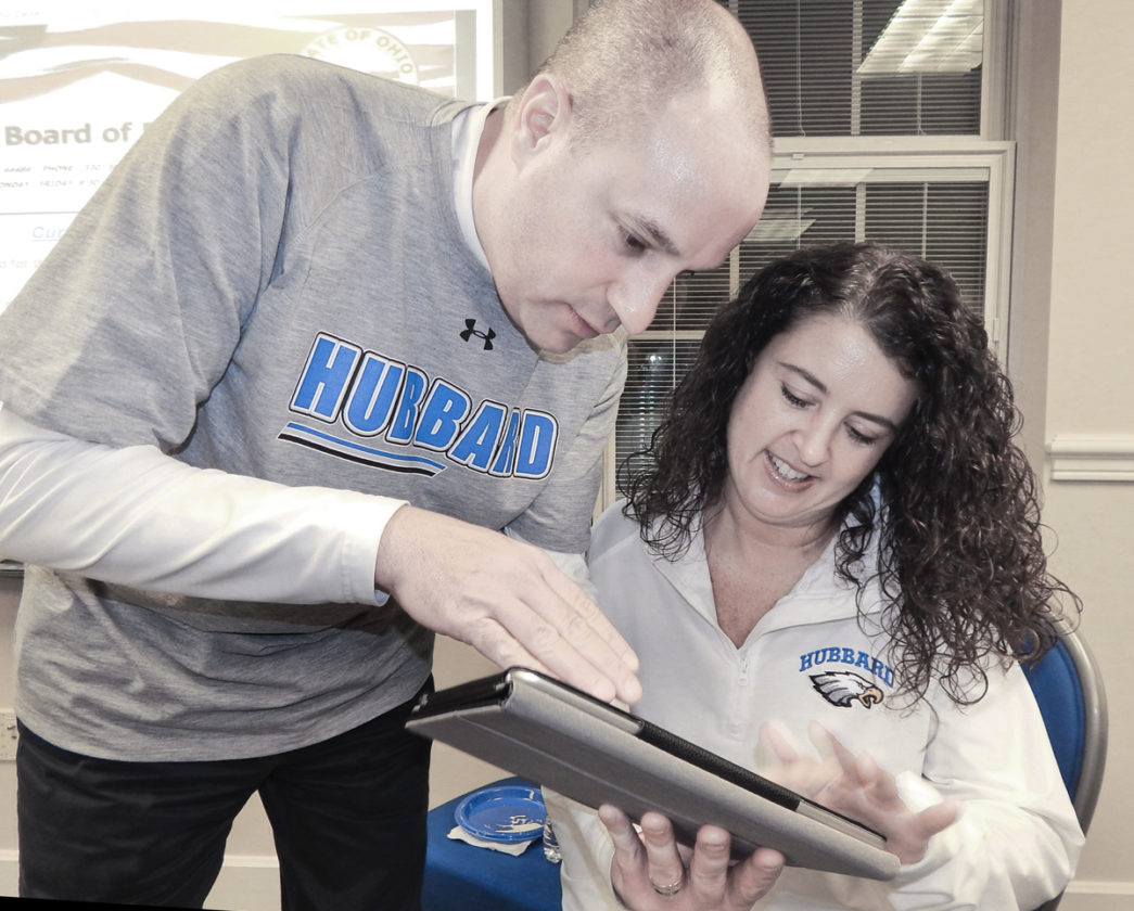 Hubbard School Superintendent Raymond Soloman, left, and School Treasurer Amber Babik, watch election results Tuesday at the board of education offices Tuesday,