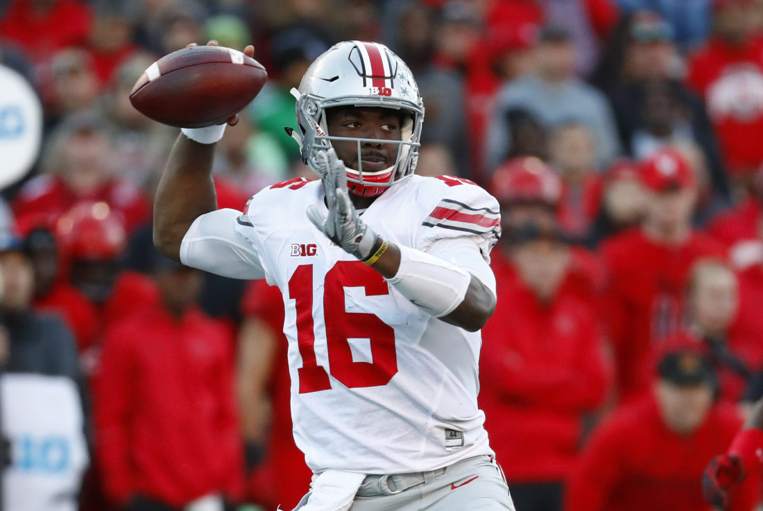 Ohio State quarterback J.T. Barrett throws to a receiver in the first half of an NCAA college football game against Maryland in College Park, Md., Saturday, Nov. 12, 2016. (AP Photo/Patrick Semansky)