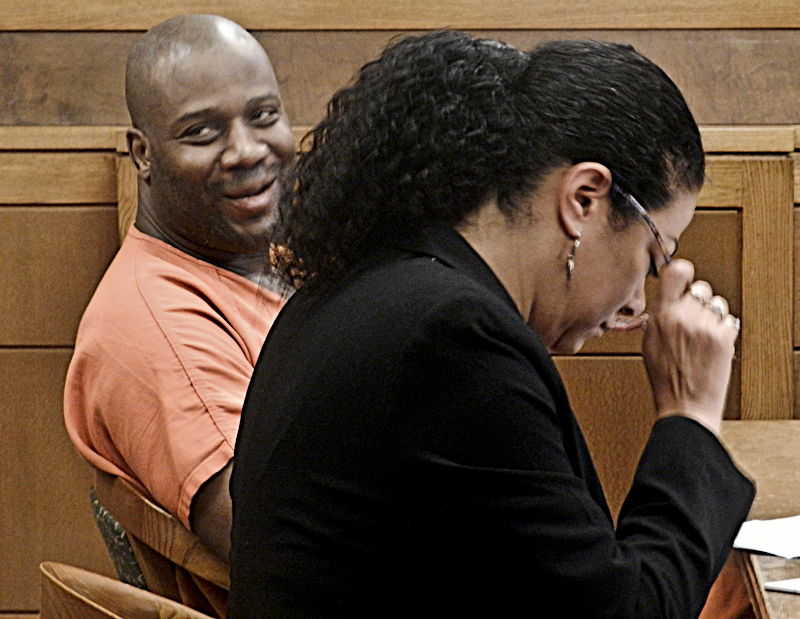 Andre Williams, left, smiles at a family member in the courtroom during his Atkins hearing before Judge W. Wyatt McKay Wednesday.
