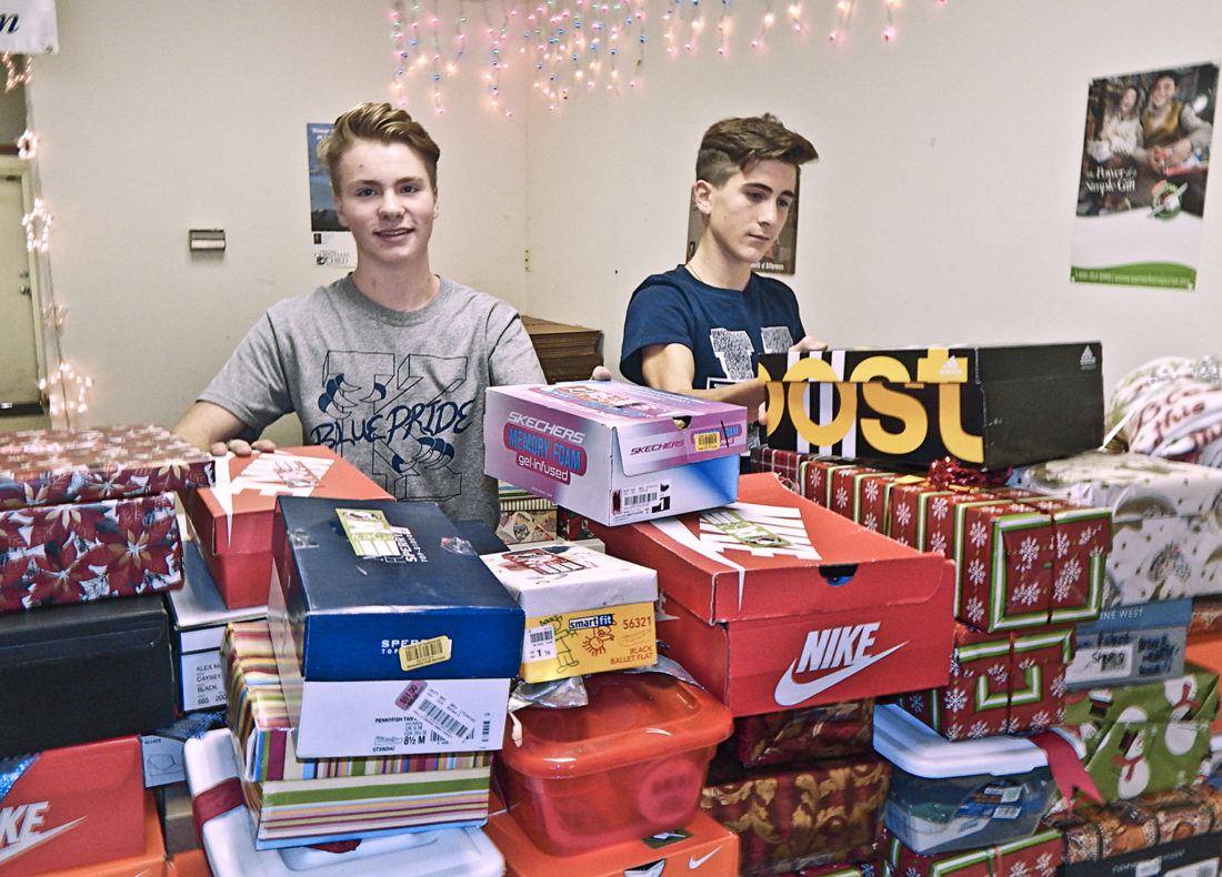 Anthony Ross, 16, of JFK, left, and Dominic Malvasi, 15, a JFK sophomore, gets assistance sorting near 100 boxes at Operation Christmas child jn Howland.