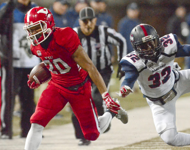 112616...R SAMFORD@YSU 7...Y-town...11-26-16... YSU's #20 Jody Webb makes a reception and breaks away from Samford's #32 Darius Harvey during 2nd Qt. actioin...by R. Michael Semple