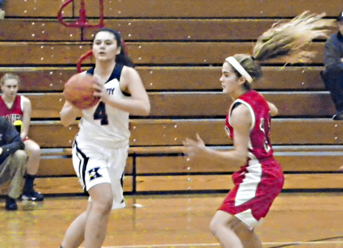 Tribune Chronicle / Eric Murray John F. Kennedy sophomore Marikate Roscoe, left, passes to a teammate while being guarded by Badger's Emma Hunkus on Thursday night during the Braves' 65-59 win at Kennedy.