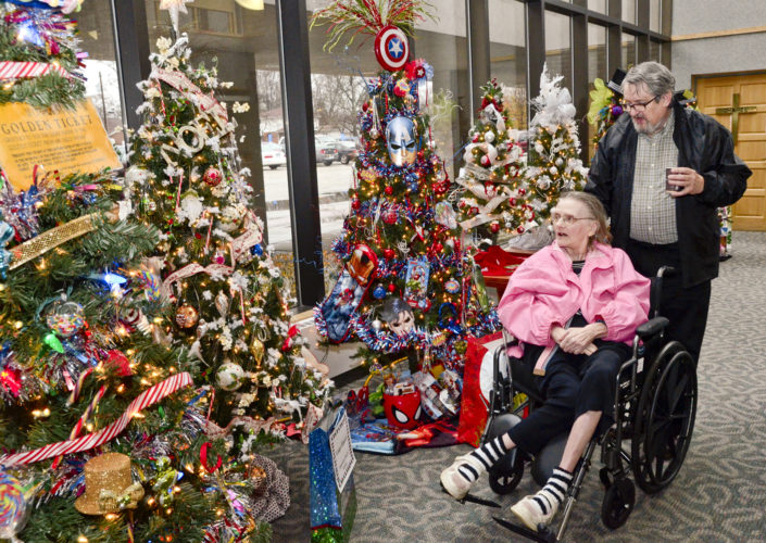 113016...R X-MAS TREES 1...Warren...11-30-16... Judy and David Wood of Cortland view the decorated Christmas trees on display at St. Joseph Warren Hospital Wednesday...by R. Michael Semple
