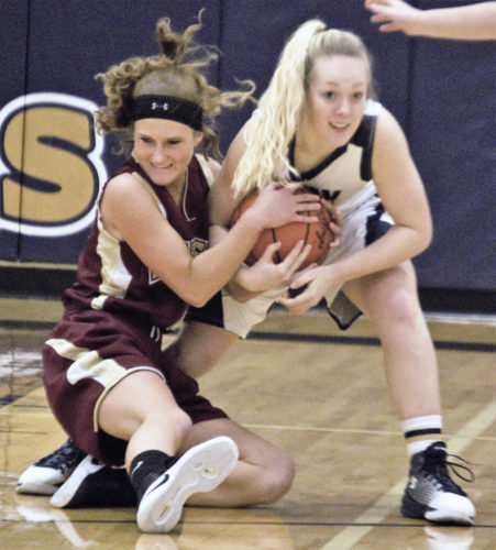 Tribune Chronicle / Bob Ettinger McKenzie Drapola, right, of Brookfield and Ashley Hall of Pymatuning Valley fight for possession on Thursday night at Brookfield.