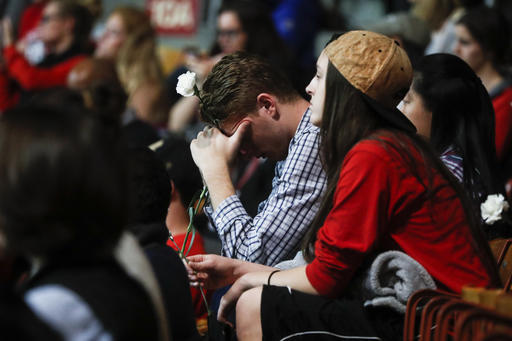 Students Tanner Hale, center, and Kayla Croyle attend a vigil following an attack at The Ohio State University campus the previous day, Tuesday, Nov. 29, 2016, in Columbus, Ohio. Investigators are looking into whether a car-and-knife attack at Ohio State University that injured several people was an act of terror by a student who had once criticized the media for its portrayal of Muslims. (AP Photo/John Minchillo)