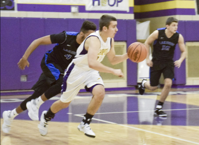 Tribune Chronicle / Eric Murray Champion's Lucas Nasonti heads downcourt with the basketball as Lakeview's Jatise Garrison (4) and Chris Muir pursue Friday night at Champion during the Golden Flashes' 57-55 win.