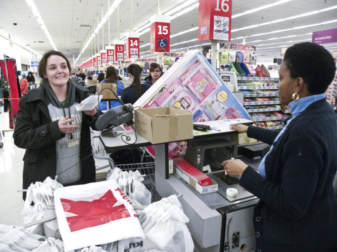 Tribune Chronicle/  Margaret Thompson  Kelly Masterson, left, of Newton Falls, returned a large Barbie dollhouse box that she found full of trash on Christmas Day to the Niles Kmart. Adrienna Steward, right, store front supervisor, called for a manager who replaced the dollhouse.  USED 2012 - CR
