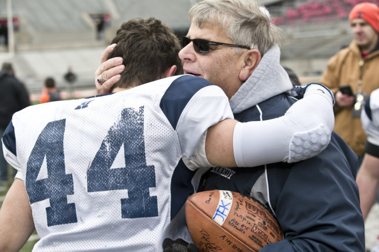 JFK's #44 Jacob Coates and head coach Jeff Bayuk celebrate their victory. OHSAA D7 Football Championship John F Kennedy Eagles vs Minster Wildcats at Ohio Stadium on OSU Campus in Columbus, OH