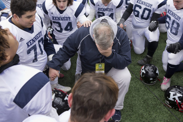 MICHAEL G TAYLOR   WARREN TRIBUNE CHRONICLE-12-03-16; JFK's Head Coach Jeff Bayuk gets emotional as he speaks with his team. OHSAA D7 Football Championship John F Kennedy Eagles vs Minster Wildcats at Ohio Stadium on OSU Campus in Columbus, OH