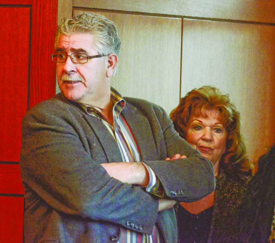 120616...R INFANTE ARRAIGN 1...12-05-16... Former Niles Mayor Ralph Infante, left, waits with his wife Judith to be arraigned on charges before visisting judge Patricia Cosgrove in Trumbull County Common Pleas court Monday afternoon...by R. Michael Semple