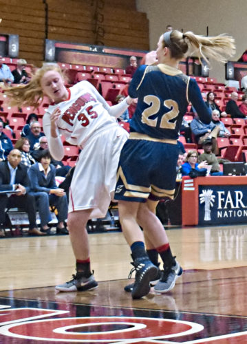 Tribune Chronicle / John Vargo Youngstown State's Kelley Wright, left fights for possession with Akron's Hannah Plybon during the first quarter of Tuesday's game at the Beeghly Center in Youngstown.