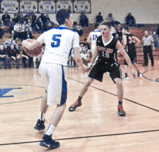 Tribune Chronicle / Eric Murray T.J. Lynch (5) of Lakeview looks for a way around Howland defender Connor Tamarkin Tuesday at Lakeview. The Bulldogs beat the Tigers, 55-53.