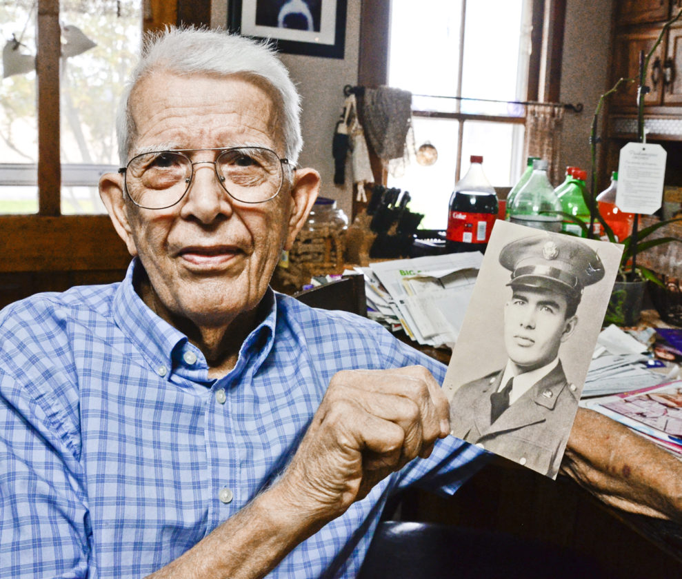 112816...R PEARL HARBOR 1...Bristol...11-28-16... Pesrl Harbor survivor James Werner with a photograph of himself when he was 18 years old and had enlisted into the U.S. Army...by R. Michael Semple