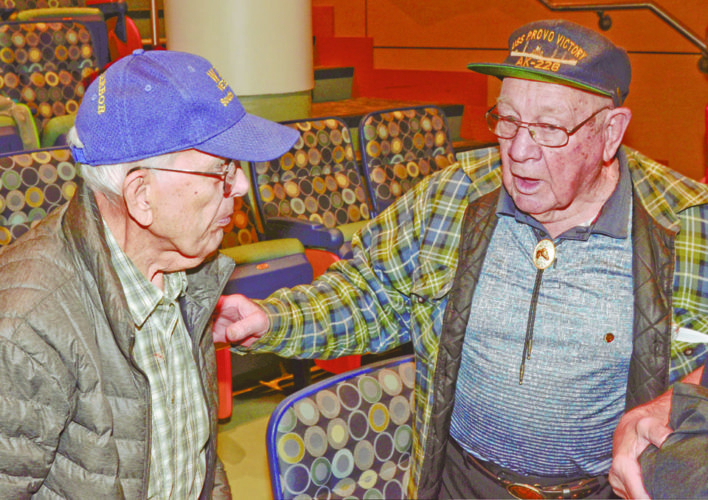 120716...R P HARBOR@KSUTC 1...Champion...12-07-16... Pearl Harbor survivor James Werner, left, talks with WWII U.S. Navy veteran George Coler of Canfield during the Pearl Harbor and Beyond program at Kent State Trumbull Wednesday evening...by R. Michael Semple