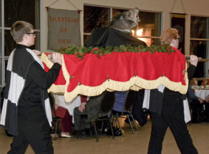 Seth Rinearson and Greg Martin carry in the Boar's head  during the Olde English Feaste, a medieval Christmastyme celebration at the Christ Episcopal Church, Friday.
