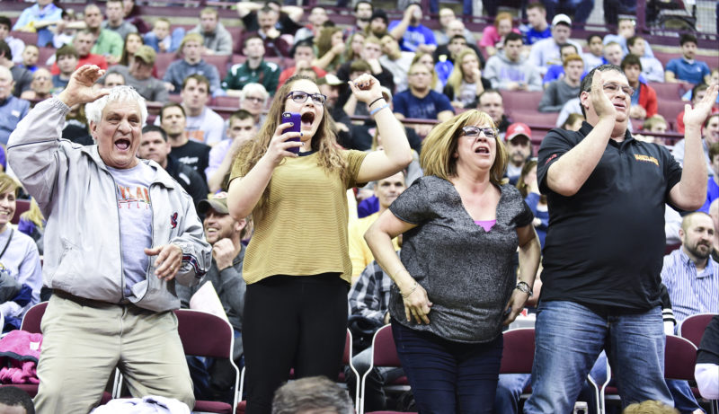 Tribune Chronicle file / Dave Dermer ABOVE: David-Brian Whisler's family, from left, grandfather Richard Radich, sister Alivia, mom Alysa and dad Dave Sr., root for the then-Howland senior when he won a state wrestling title in March 2015.