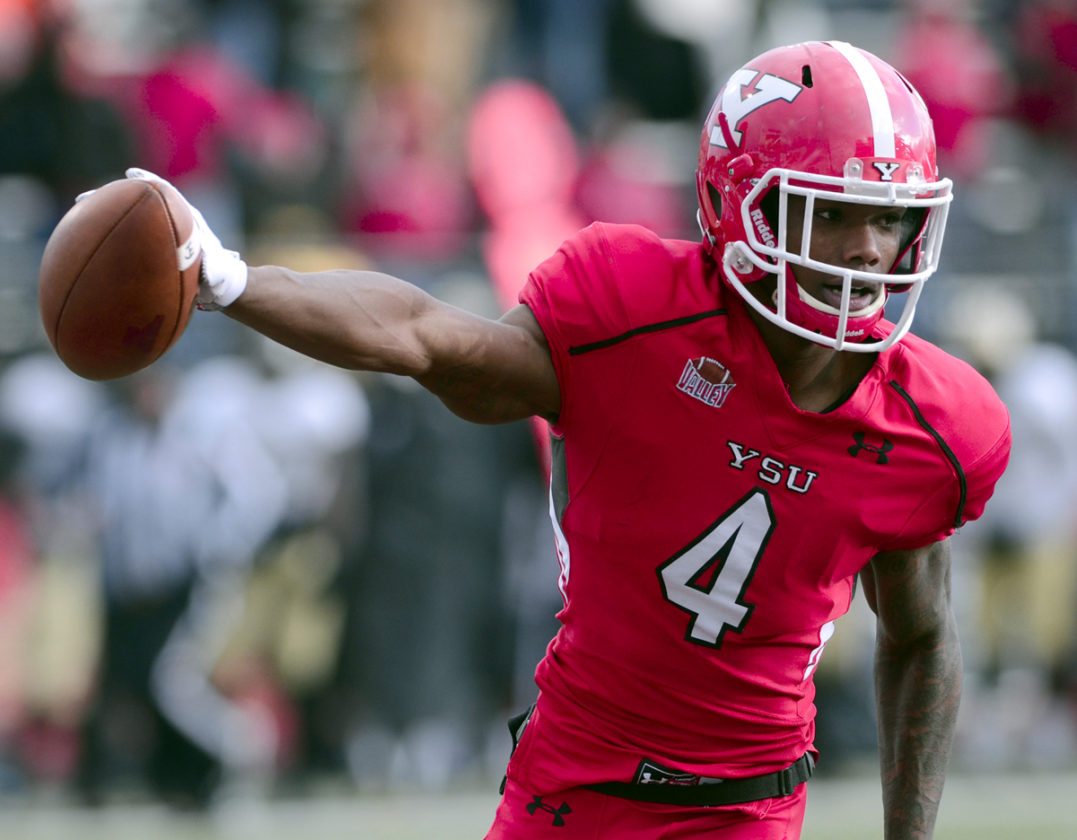 Tribune Chronicle  R. Michael Semple Youngstown State receiver Damoun Patterson makes a reception over a Wofford defender and rushes in for a second-quarter touchdown during last week's quarterfinal win over Wofford in Youngstown. The Penguins face