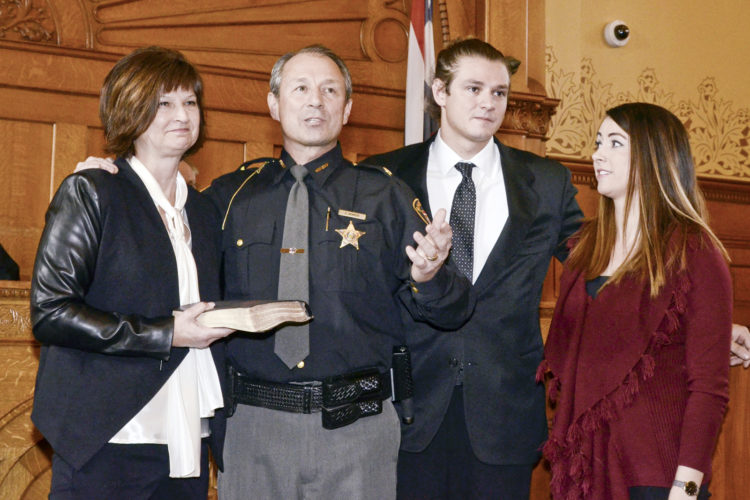 122816...R OFFICIAL 1...Warren...12-28-16... Newly elected Trumbull County Sheriff Paul Monroe, 2nd from left, introduces his family at the Oath of Office Ceremony Wed. morning at the Trumbull County Courthouse...From left, wife, Tina Monroe, Paul Monroe, son Taylor Monroe and daughter Krista Monroe..by R. Michael Semple