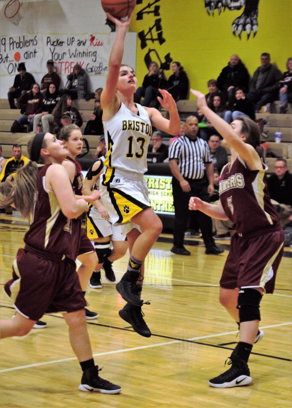 Tribune Chronicle / Bob Ettinger Brook Songer of Bristol puts up a shot in the key as Ashley Hall (3) and Olivia Holden (5) of Pymatuning Valley defend on Monday night at Bristol.