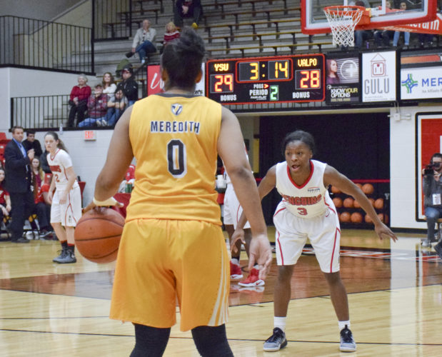 Tribune Chronicle / John Vargo Valparaiso's Maya Meredith is guarded by Youngstown State's Indiya Benjamin during Saturday's game at the Beeghly Center. YSU won 76-70 for the Penguins second straight win.