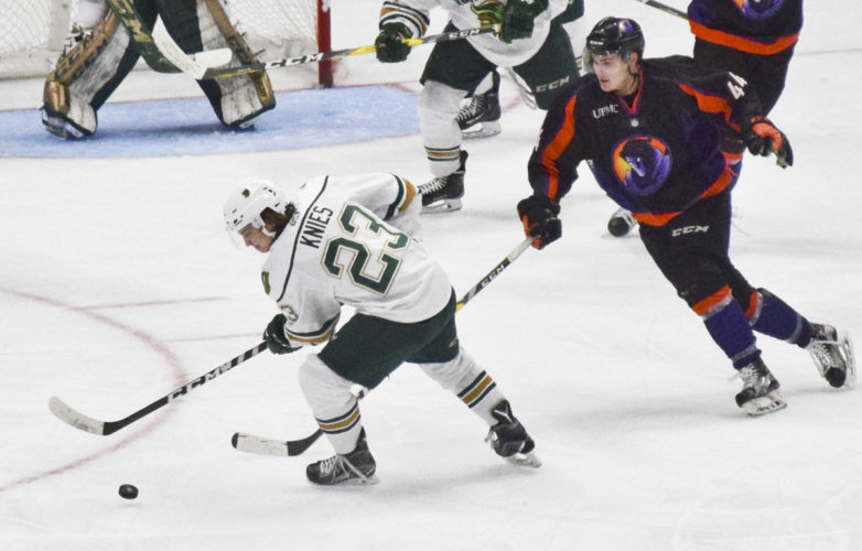 Tribune Chronicle / Eric Murray Sioux City's Phillip Kines, left, skates away from Youngstown's Coale Norris during Saturday's game at the Covelli Centre. The Phantoms won in overtime, 2-1.