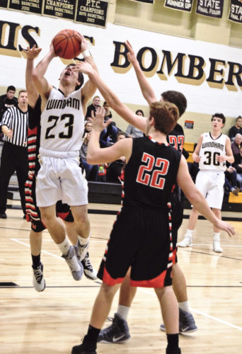Tribune Chronicle / Bob Ettinger Eric Park of Windham (23) goes in for a layup as Justin Sherwood (22) and several Chalker teammates collapse into the paint in Northeastern Athletic Conference action on Friday night in Windham.