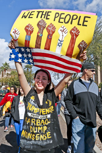 A demonstrator holds a sign as she marches in support of the Women's March on Washington Saturday, Jan. 21, 2017, in Phoenix. Thousands of protesters in Phoenix joined in support of those in cities around the globe protesting against Donald Trump as the new United States president. (AP Photo/Ross D. Franklin)