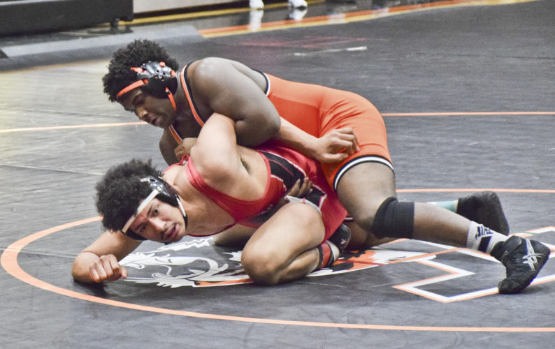 Tribune Chronicle / Joe Simon Howland's Isom Julian, top, laces an arm-bar on Painesville Harvey's Dimitrius Mitchel during the 195-pound championship match Saturday at the Howland Invitational. Julian won, 6-1.