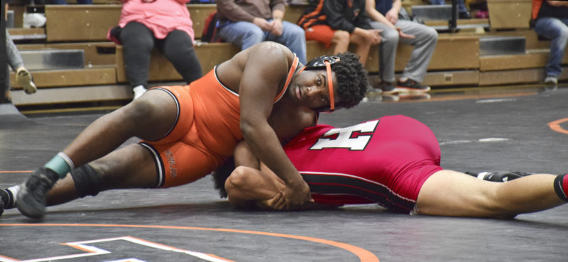 Tribune Chronicle / Joe Simon Howland's Isom Julian (top) wrestles against Dimitrius Mitchel of Painesville Harvey during the Howland Invitational in January. Julian and the Tigers join the rest of the area's wrestling schools in the Eastern Ohio Wrestling League championships tonight and Saturday at Austintown Fitch.