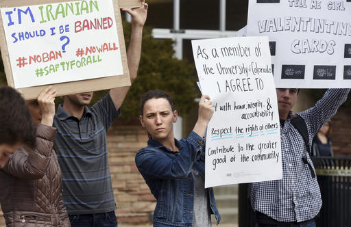 Allie Morgan, a University of Colorado graduate student, is among dozens of people at a travel ban protest at the University of Colorado in Boulder on Thursday, Feb. 9, 2017. ( Cliff Grassmick/Daily Camera via AP)