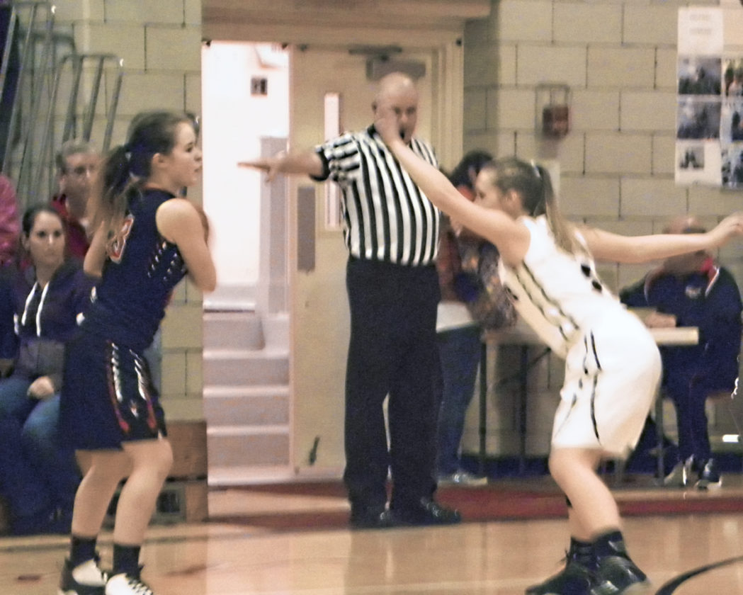 Jordan Beach, left, of Lordstown is guarded by Emily Strama of Mathews Thursday night.