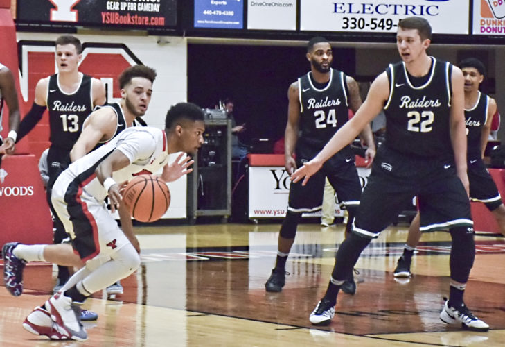 Tribune Chronicle / John Vargo Youngstown State's Cameron Morse, with ball, tries to work for a shot against the entire Wright State defense Thursday night at Beeghly Center. The Raiders beat the Penguins, 84-81, despite 35 points from Morse.